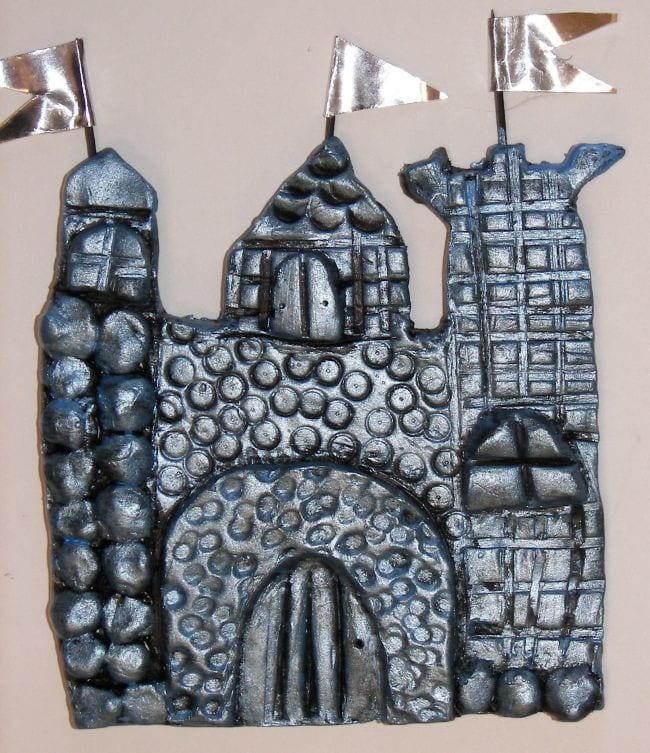 Flat castle made of textured clay painted silver