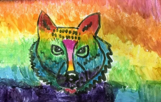 Boldly drawn tiger head with a rainbow background (Fourth Grade Art Projects)