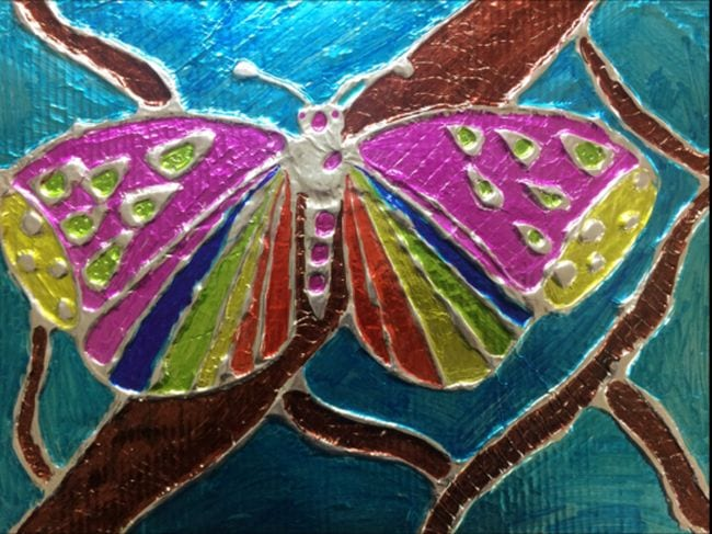 Butterfly made with glue lines on foil, colored in with markers