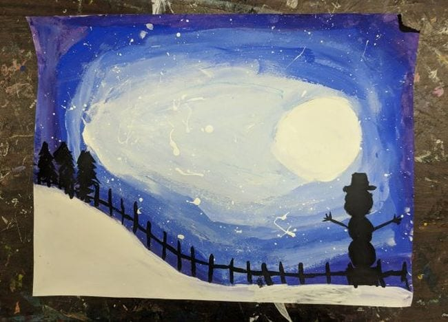 Painted nighttime winter scene with full moon and snowman and tree silhouettes (Fourth Grade Art)