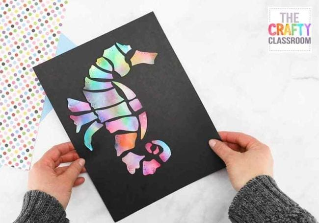 Seahorse in pastel colors pasted on black construction paper