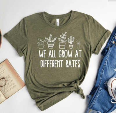 """Teacher shirt with plants """"we all grow at different rates"""""""