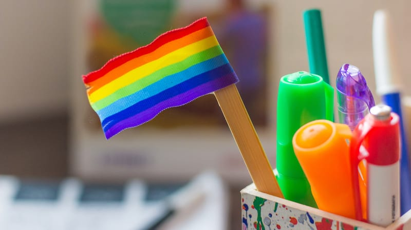 Small rainbow flag on a pencil on a desk