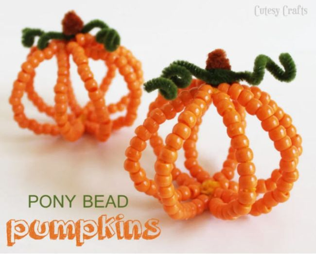 Pumpkins made of pipe cleaners and orange plastic beads (Halloween Activities)