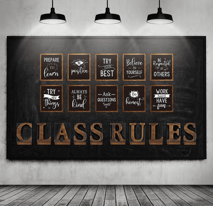 """Several wall hangings on a dark blue wall with sayings that are meant to guide students on their educational journey along with letters on the wall that spell out """"CLASS RULES."""""""