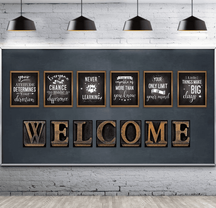 Several wall hangings on a dark blue wall with motivational sayings and letters that spell out the word 'WELCOME.'