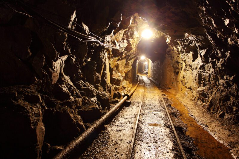 Railway running through dimly lit mine shaft