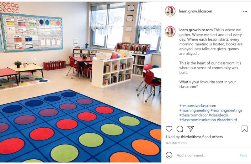 Blue rug with colorful polka dots in classroom with white walls and organizer
