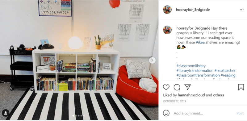 Black and white striped carpet in classroom with white organizer and red sitting cushion