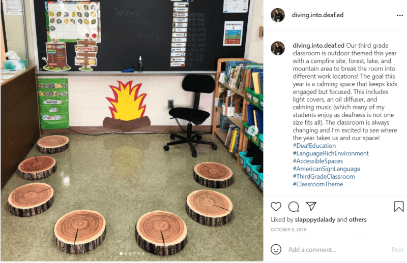 Tree stumps with fake campfire around the blackboard in a classroom