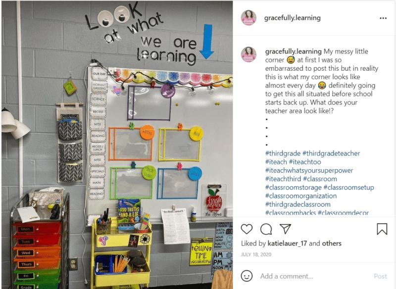 Googly eyes and organizers hang on grey classroom wall