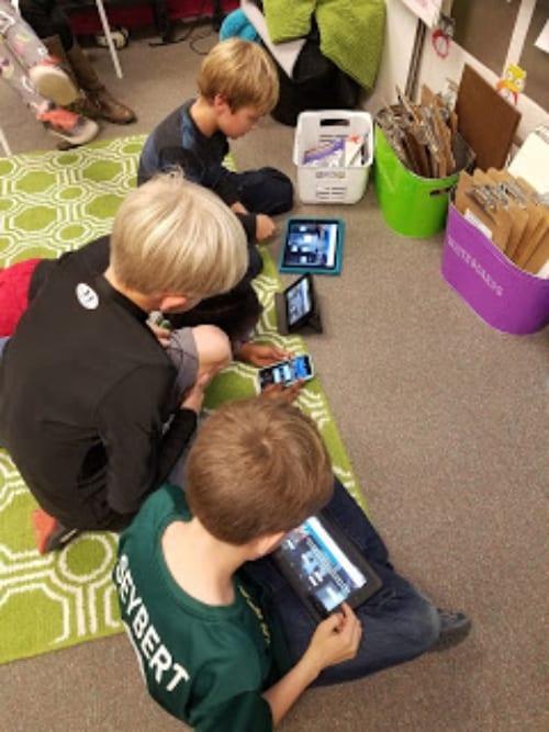 classroom children on iPads