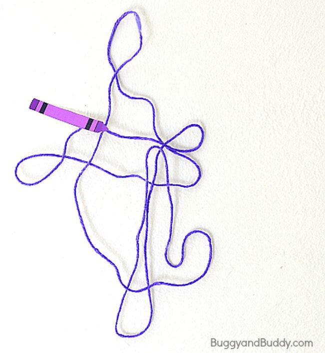 Purple yarn stiffened and shaped into a pattern, with a paper purple crayon at one end (Kindergarten Art)