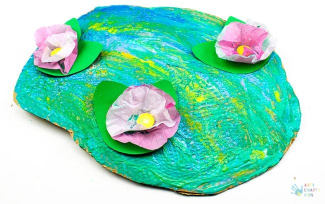 Paper pond colored with swirled paint, with tissue paper water lilies on top (Kindergarten Art)