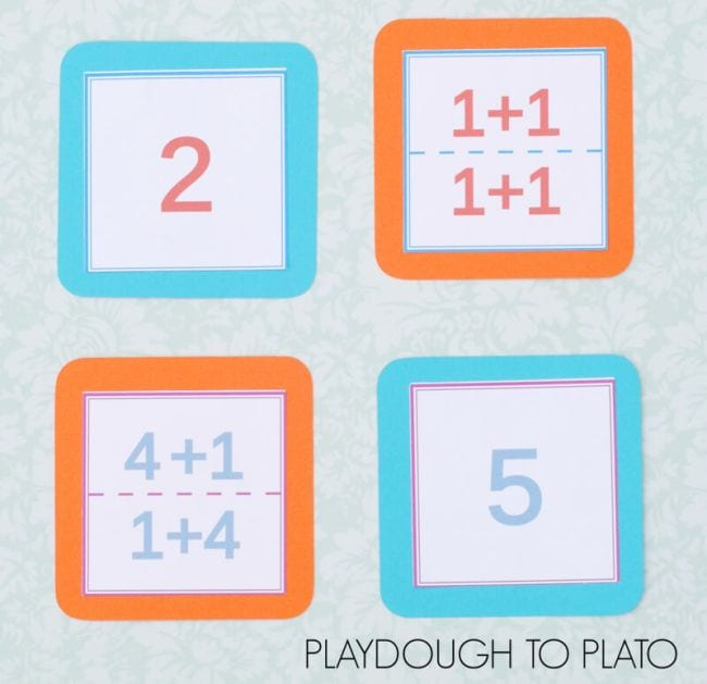 Four cards with math problems or answers on each