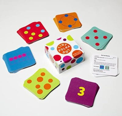 Box cover and sample cards for the Math for Love Tiny Polka Dot Game with various dot configurations and numbers for children to match as an example of best preschool card games and board games for the classroom