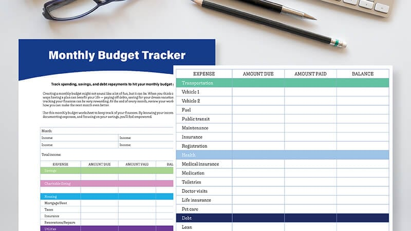 Close up of monthly budget tracker worksheet on white desk with pair of eyeglasses and two pencils