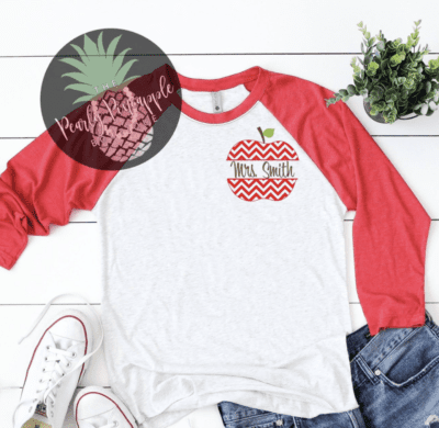Red and white baseball tee with Mrs. Smith written inside an apple