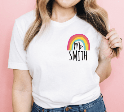 White tshirt with teachers name and a rainbow, as an example of Etsy teacher shirts