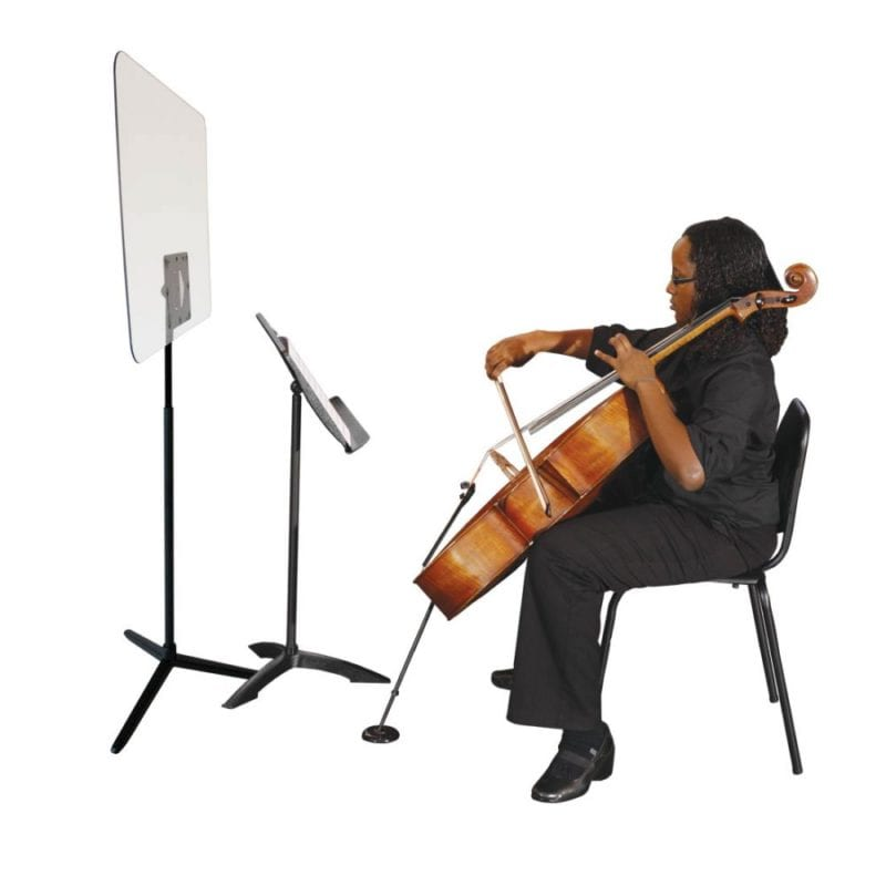 Student playing cello and using plastic shield