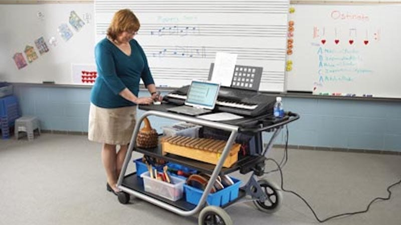 Music teacher with a cart full of supplies