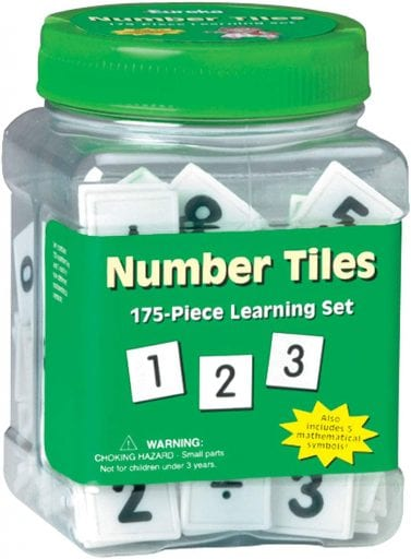 Tub of squares with numbers written on them.