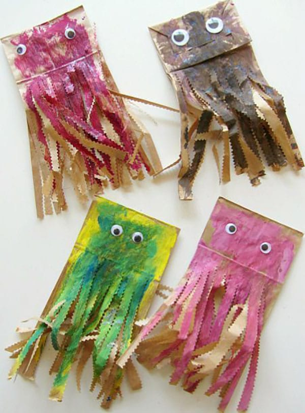 Painted paper lunch bags turned into jellyfish with googly eyes and the bottom edges trimmed into strips