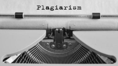 Plagiarism typed on an old typewriter (Online Plagiarism Checkers)