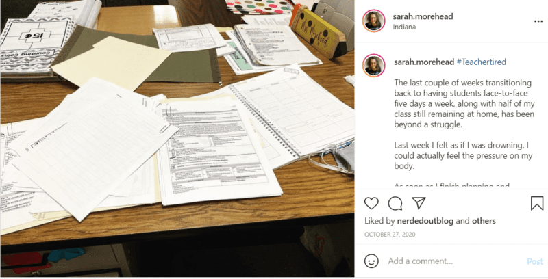 Teacher's desk during a pandemic covered in papers