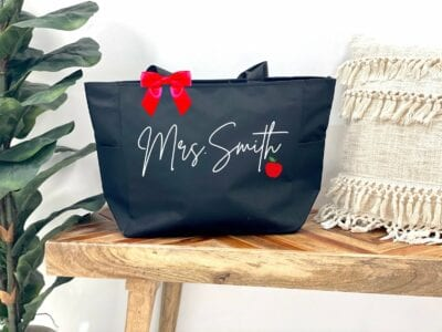 Personalized name teacher tote bag in black with apple