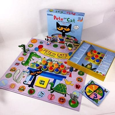 Pete the Cat The Missing Cupcakes game box, board, spinner, and multicolored cupcake game pieces laid out to demonstrate preschool game play