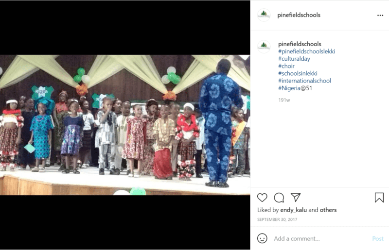 Teacher and students on stage for a pageant at school in Nigeria