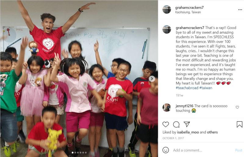 Teacher jumping with group of young students in a classroom