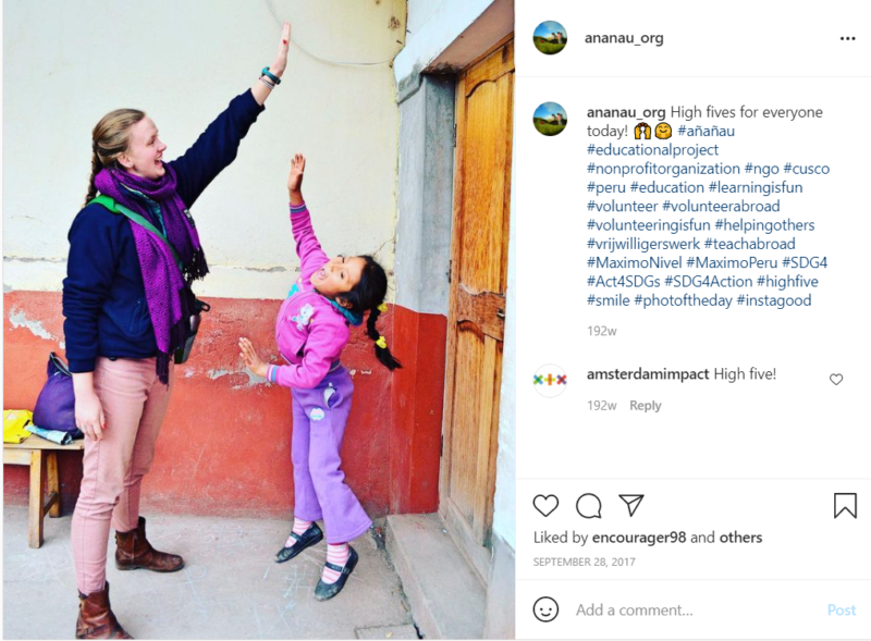 Teacher giving young student in purple clothes a high five outside school