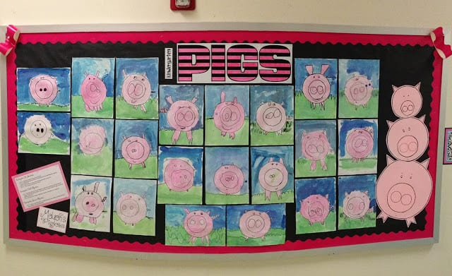 Bulletin board titled Pigs, displaying artwork of pigs made from circles