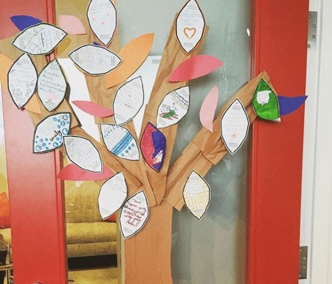 Paper tree hung with paper leaves with poems written on them