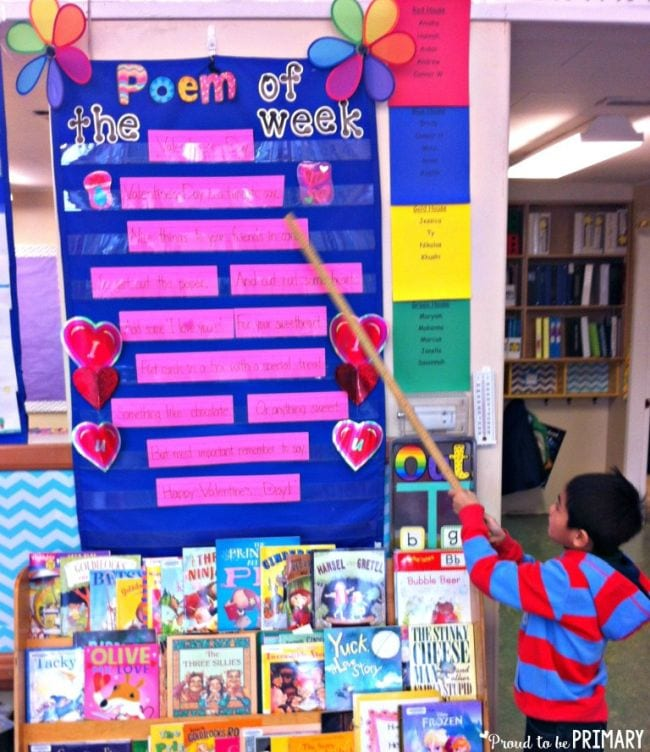 Student using a pointer to point out the words of a poem made using sentence strips in a pocket chart