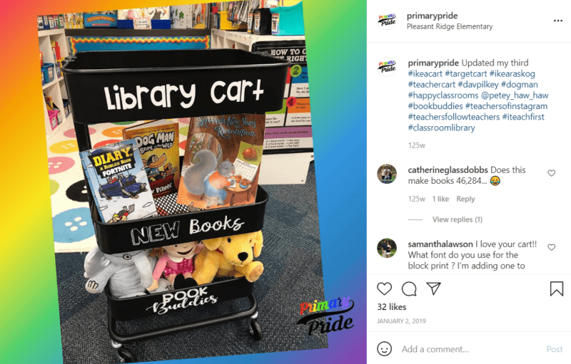 Black teacher cart labeled library cart with a shelf for new books filled with books and book buddies full of stuffed animals in a classroom