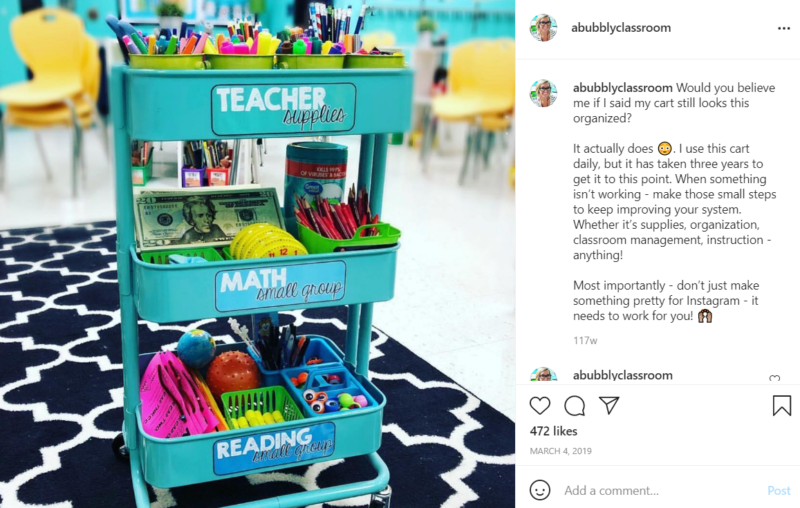 Teal, three level organization cart filled with school supplies in a classroom