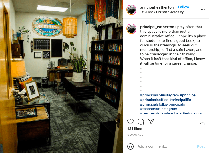a principal's office featuring bookcases, a sofa and coffee table and a desk in the background