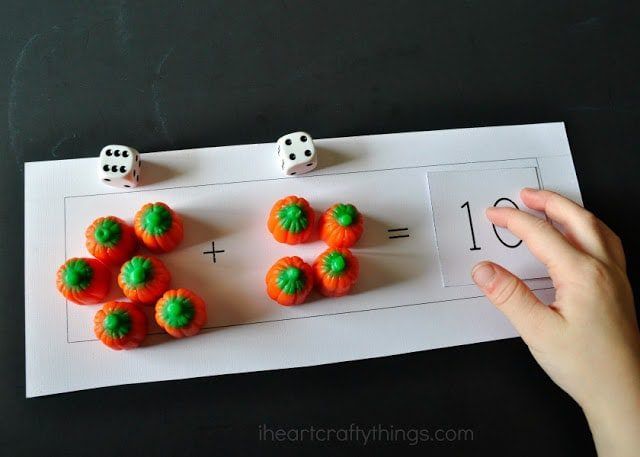 a math worksheet with candy pumpkins, dice and numbers