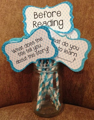 Jar with first grade reading comprehension question cards on colorful sticks