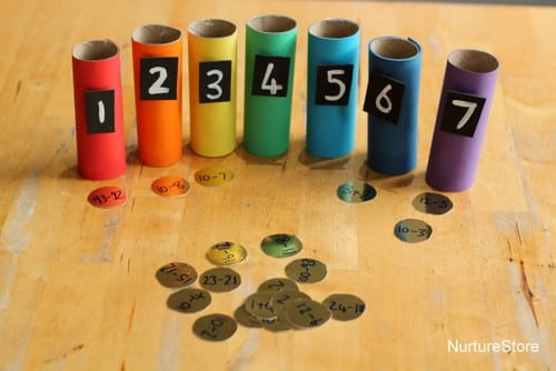 Rainbow classroom math activities with numbered colored tubes and math facts