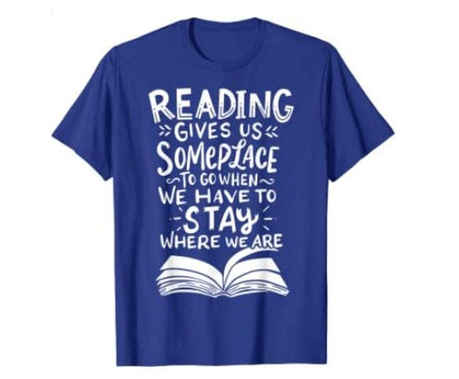 Blue t-shirt reading Reading Gives Us Someplace To To When We Have To Stay Where We Are (Reading Shirts)