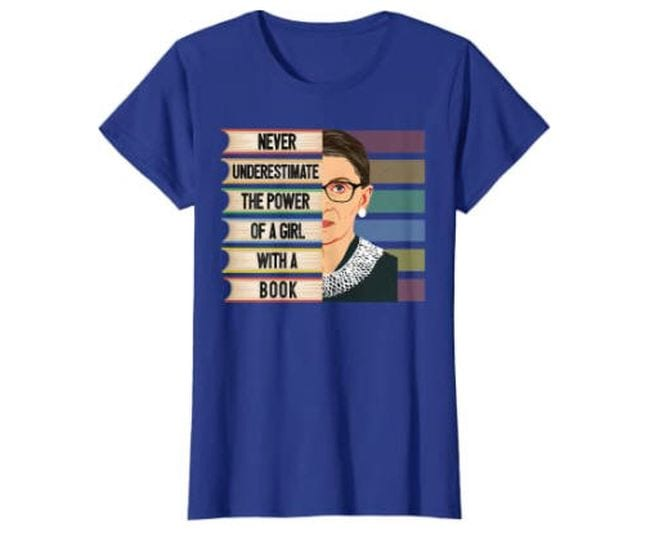 Blue t-shirt with picture of Ruth Bader Ginsburg saying Never Underestimate The Power of a Girl With a Book