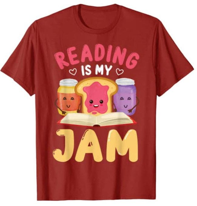 Red t-shirt with pictures of peanut butter and jelly saying Reading Is My Jam