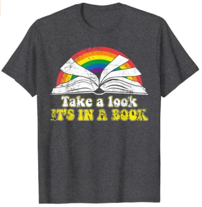 T-shirt with open book in front of a rainbow, and text Take a look, It's in a book (Reading Books)