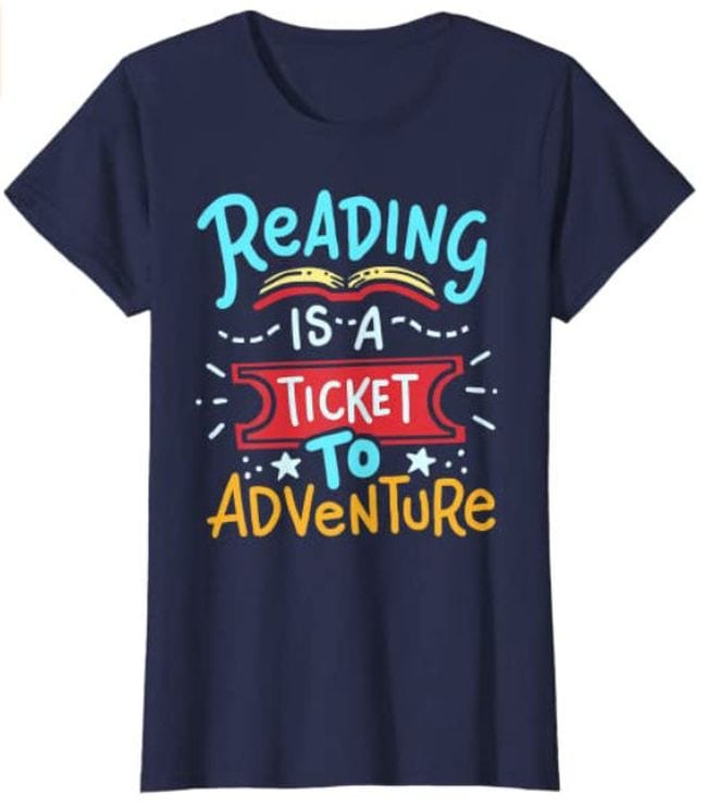 Navy blue t-shirt with message Reading is a Ticket to Adventure