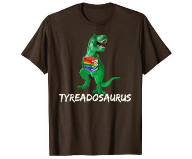 Brown t-shirt with picture of a dinosaur holding a book reading Tyreadosaurus