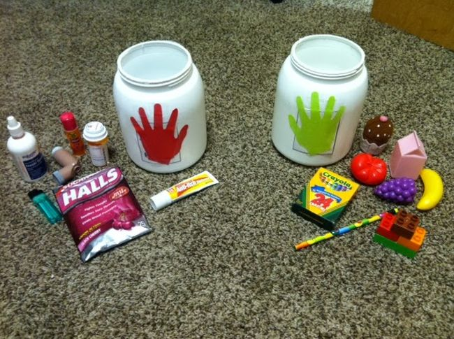 Two jars with red and green handprints, with items like cough drops and crayons